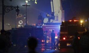 Fire trucks attend a blaze at the state secretariat building in Jakarta, Indonesia.