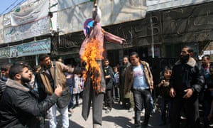 Palestinians set fire to an effigy of US President Barack Obama during a protest against Obama's visit to the West Bank, in the southern Gaza Strip town of Rafah.