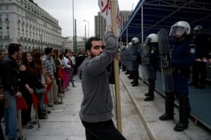 Greek students demonstrate outside the parliament in Athens