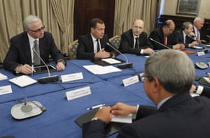 Russia's Prime Minister Dmitry Medvedev (2nd L) attending a conference of the Russian Union of Industrialists and Entrepreneurs in Moscow, March 21, 2013.