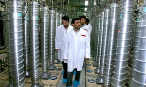 Iranian President Mahmoud Ahmadinejad, centre, visits the Natanz uranium-enrichment facility some 200 miles south of the capital, Tehran.