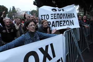 Employees of the Laiki (Popular) Bank, which is the second largest bank on the island, facing closure, demonstrating outside the House of Representatives , Nicosia Cyprus , 21 March 2013, following the uncertainty over their fate.