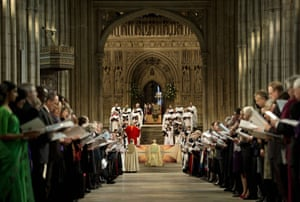The Archbishop of Canterbury kneels at the altar in Canterbury Cathedral prior to his enthronement