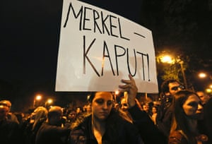 A protester holds a placard during a rally by employees of Cyprus Popular Bank outside the parliament in Nicosia March 21, 2013.