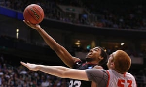 Harvard guard Wesley Saunders (23) takes a shot while defended by New Mexico center Alex Kirk (53) during the second half of their second round NCAA tournament basketball game in Salt Lake City, Utah, March 21, 2013. Harvard beat New Mexico 68-62. The NCAA win was the in Harvard history. REUTERS/Jim Urquhart (UNITED STATES - Tags: SPORT BASKETBALL TPX IMAGES OF THE DAY) :rel:d:bm:GF2E93M0F3J01