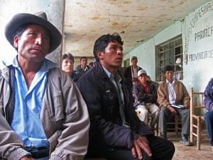 Peruvian villagers watching presentation