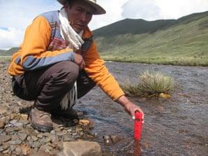 Farmer measures pH river