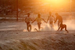 24 hours: Allahabad, India: Indian children play on the banks of the river Ganges