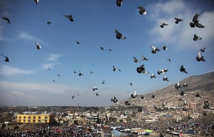 24 hours: Kabul, Afghanistan: Pigeons fly over the sky during Nowruz celebrations