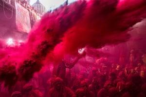 24 hours: Barsana, India: Hindu devotees play with coloured pigment
