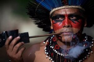 24 hours: Rio de Janeiro, Brazil: An indigenous man smokes a pipe
