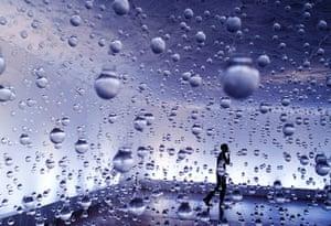 24 hours: Rio de Janeiro, Brazil: A man walks among lightbulbs filled with water