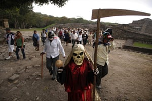 24 hours: Papantla, Mexico: People march during a protest at Tajin