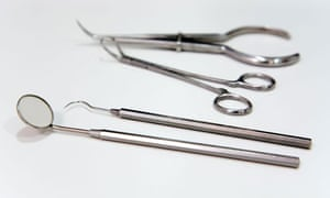 dentist tools on white surface - focus on foreground