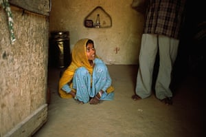Modern slavery: A child bride cowers at her husband's feet