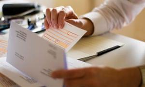 Doctor sorts through paperwork