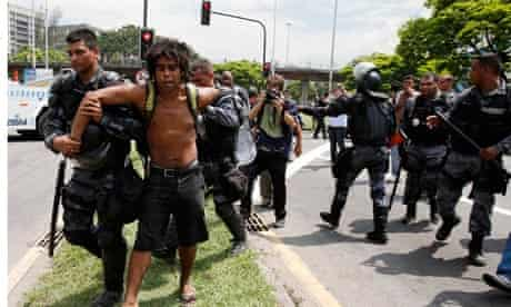 A supporter of the indigenous community is arrested