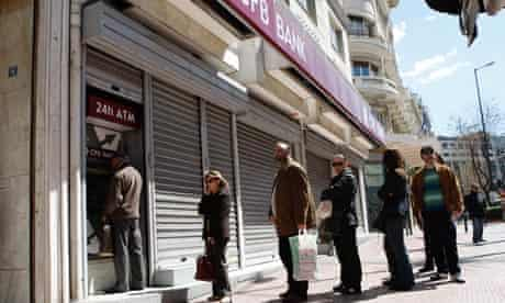 People queue at ATM of the Greek branch of Cyprus Popular Bank, Athens, Greece - 22 Mar 2013