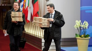 Personnel carry in boxes of pizza to the European Council building as an emergency eurogroup meeting takes place in Brussels on Sunday, March 24, 2013.