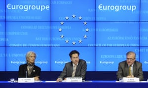 Dutch Finance Minister and President of the Eurogroup Council Jeroen Dijsselbloem (C) takes part in a joint press conference with International Monetary Fund (IMF) Managing Director Christine Lagarde (L) and EU Commissioner for Economic and Monetary Affairs Olli Rehn (R) after a Eurogroup Council meeting at EU headquarters in Brussels on March 25, 2013.