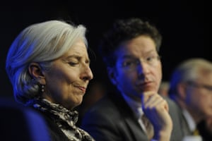 International Monetary Fund (IMF) Managing Director Christine Lagarde (L) takes part in a joint press conference with Dutch Finance Minister and President of the Eurogroup Council Jeroen Dijsselbloem (C) after a Eurogroup Council meeting at EU headquarters in Brussels on March 25, 2013.