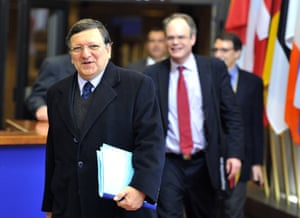 European Commission President Jose Manuel Barroso (L) leaves following a Eurozone meeting early on March 25, 2013 at EU headquarters in Brussels.