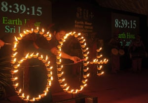 WWF Earth Hour: A woman lights up oil lamp to mark Earth