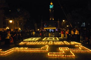 WWF Earth Hour: People standing next to candles arranged to read Tunisia