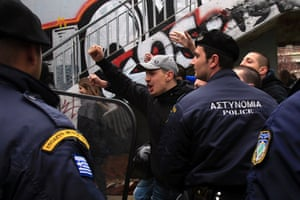 A supporter of the ultra nationalist party of Golden Dawn shouts at protesters  as they protest against measures imposed to Cyprus  during a parade to commemorate the independence day at the northern Greek city of Thessaloniki on Monday March 25, 2013.