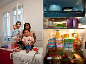 Big Picture - Fridges: white man and black woman and two children stand with pic of open fridge
