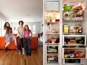 Big Picture - Fridges: woman with two children stand in front of orange sofa with pic of fridge