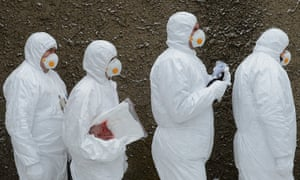 Workers in protection suits and masks leave a shelter during an emergency exercise in the nuclear power station Dukovany, near Trebic, Czech Republic. Hundreds of plant workers, local firefighters, policemen and authorities took part in a three day simulated radiation emergency exercise.