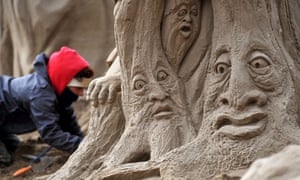 A sculptor places the finishing touches to an entry into the Weston-Super-Mare Sand Sculpture Festival.  There are twenty award winning sand sculptors from across the globe working to Hollywood themed sculptures including Harry Potter, Marilyn Monroe and characters from the Star Wars films.