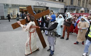 We see some unusual sights on the picture desk each day but Jesus Christ carrying his cross past Next in Liverpool is quite surreal. Mathew Hunter plays the part of Jesus during The Walk of Witness which gives people the chance to take time out during Holy Week and join the event  to consider the the Easter Story.