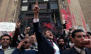 Former presidential candidate Khaled Ali, centre, protests in front of the general prosecutor's office in Cairo, Egypt, a day after the prosecutor general ordered the arrest of a prominent blogger and four others for allegedly instigating violence with comments posted on social media. The charges stem from clashes between supporters and opponents of the country's Islamist president last week that left 200 injured.