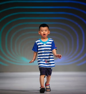 Want to know what the kids are wearing? A little model shows a desing from the Chashan group at the China International Clothing and Accessories Fair on the sidelines of the Fashion Week in Beijing.