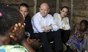 Britain's Foreign Secretary William Hague is UNHCR Special Envoy Angelina Jolie's companion during a visit to Nzolo camp in the Democratic Republic of Congo. They have travelled to the region to raise awareness of warzone rape.