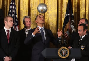 U.S. President Barack Obama bounces a soccer ball on his head while hosting a ceremony honoring players and coaches from the National Hockey League Stanley Cup-winning Los Angeles Kings and the Major League Soccer champions Los Angeles Galaxy in the East Room of the White House in Washington, DC.