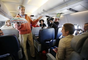 And we stay with U.S. politicians doing unusual things for the media. Secretary of State John Kerry presents a birthday cake to CBS correspondent Margaret Brennan on his flight from Kabul to Paris. Photograph: Jason Reed/AFP/Getty Images