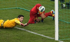 Spain's Pedro Rodriguez Ledesma scores against France's Hugo Lloris during their 2014 World Cup qualifying match at the Stade de France