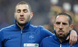 France's Karim Benzema and Franck Ribery listen to the national anthem prior to their World Cup Group I qualifying soccer match against Spain at Stade de France