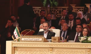 Moaz al-Khatib took Syria's vacant seat at the Arab League summit in Doha on Tuesday despite resigning as head of the Syrian National Coalition on Sunday.