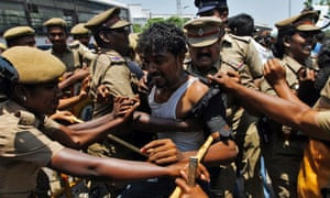 Rather more hostile hands. Police detain a college student during a protest in the southern Indian city of Chennai. Dozens of students held a protest against Sri Lanka demanding a probe into alleged war crimes, the protesting students said.