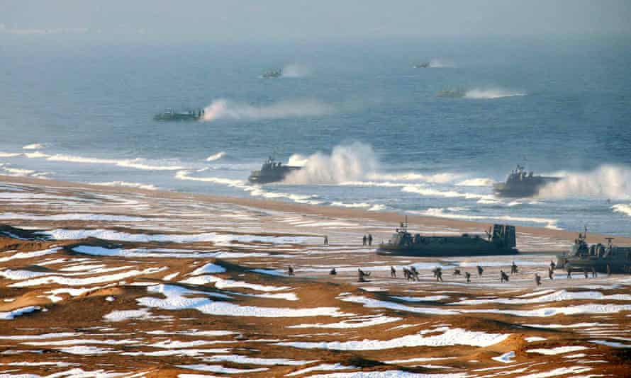This picture released by North Korea's official Korean Central News Agency on 26 March 2013 and taken on 25 March 2013 appears to show the landing and anti-landing drills of KPA Large Combined Units 324 and 287 and KPA Navy Combined Unit 597 at an undisclosed location on North Korea's east coast.