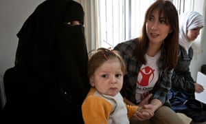Samantha Cameron meeting mother Farah and her disabled son Ali in a Save the Children supported health clinic in the Bekaa Valley, Lebanon, close to the Syria border.