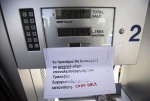A sign is attached to a petrol pump that explains to clients that they can only pay by cash, in the capital Nicosia on March 27, 2013.