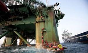 Greenpeace activists climb oil rig