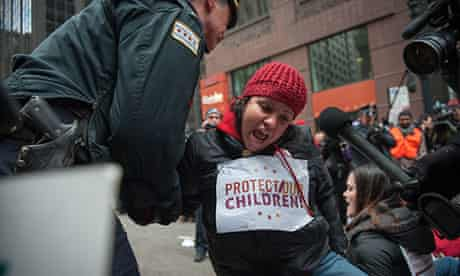 A protester is arrested in front of Chicago City Hall during a demonstration against school closures