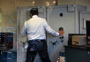 An employee opens a safe inside a Bank of Cyprus branch before it opened in Nicosia March 28, 2013.