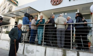 People wait outside a Coop bank branch in Nicosia, Cyprus, Thursday, March 28, 2013.